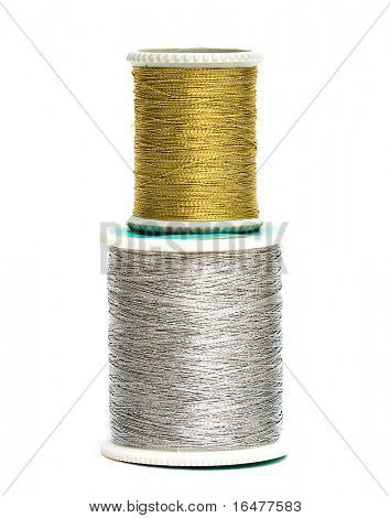 golden and silver spools of threads