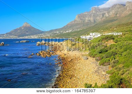 View of Sentinel peak in Hout Bay from the scenic Chapman's Peak Drive, Cape Town, South Africa in a sunny day.
