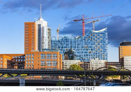 HAMBURG GERMANY - JUNE 25 2014: The Elbphilharmonie concert hall in the port of Hamburg. The tallest inhabited building of Hamburg with a height of 110 metres. Announced opening date is 11 Jan 2017