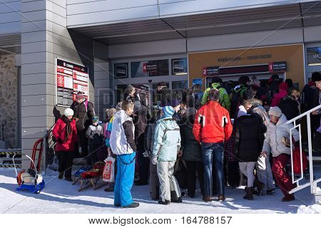 SLOVAKIA STARY SMOKOVEC - JANUARY 06 2015: The crowd in the queue for tickets to cable car in High Tatras mountains. Smokovec is a popular resort for skiing and hiking at an altitude of 990 m a.s.l.
