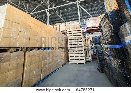 Warehouse transport and logistics company. Cardboard boxes wrapped in stretch film.
