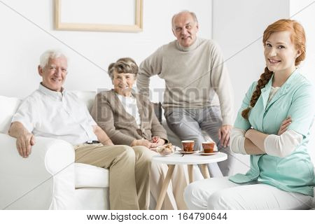 Comfortable professional nursing home with smiled seniors