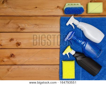 Set of variety cleaning supplies on wooden table top view