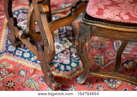 Aged wooden furniture. Antique chair with soft cushion. Buy antiques at good price.