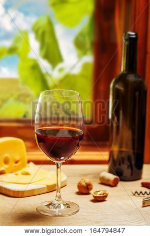 Glass and bottle of wine on table