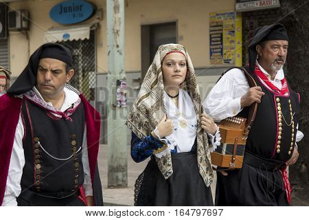 QUARTU S.E., ITALY - September 15, 2013: Wine Festival in honor of the celebration of St. Helena - Sardinia - group of people in traditional Sardinian costume