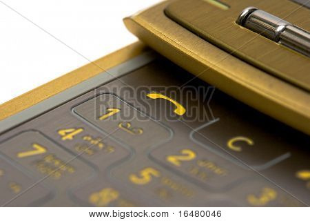 close-up of gold mobile phone over white background(shallow DOF)