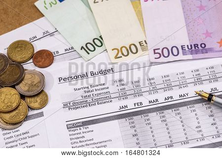 Family Budget - document costs Euro Money pen and calculator.