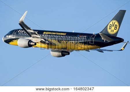 DUSSELDORF GERMANY - DEC 16 2016: Eurowings Airbus A320 painted in Borussia Dortmund colours departing from Dusseldorf airport.