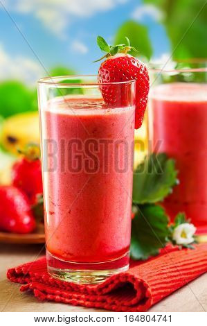 Fresh strawberry smoothies. Healthy drink. Outdoor shot.