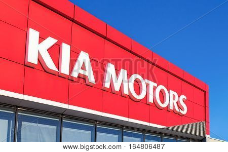 SAMARA RUSSIA - MAY 22 2016: The emblem KIA motors on the office of official dealer. Kia Motors is South Korea's second-largest automobile manufacturer