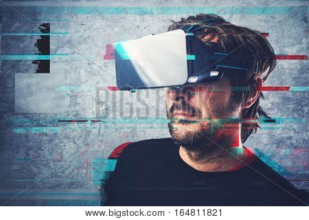 Man with 3d virtual reality headset and digital glitch effect