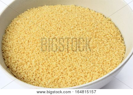 Instant Couscous in a whithe bowl in the kitchen