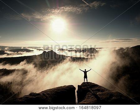 Mountain Summit. Happy Man Gesture Raised Arms.