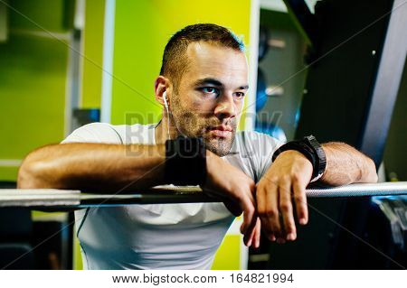 Handsome Bodybuilder Concentrated In Gym