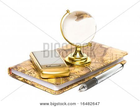 Notebook, mobile phone and globe