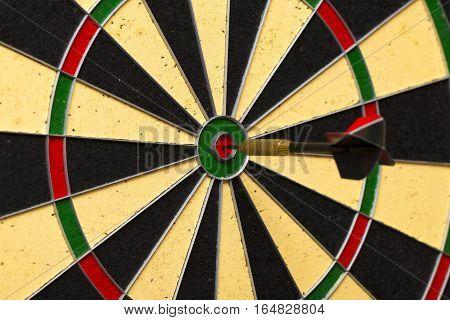 Dart Arrow Hitting In The Target Center