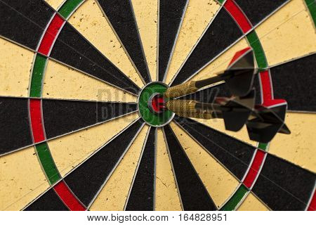 Dart Arrows Hitting In The Target Center