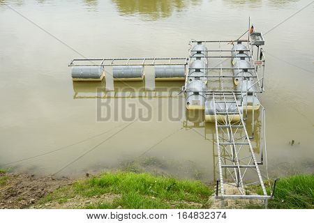 Martfu Hungary - April 25 2015. Construction of a small recreational floating river pier. Wooden floor is still missing making the full structure visible.