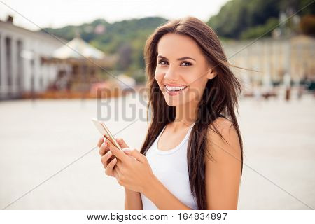 Portrait Of Beautiful Smiling Woman  Writing Message In City