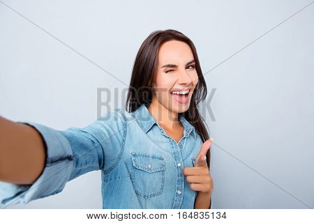 Selfie Of Happy Woman Showing Thumb Up And Winking