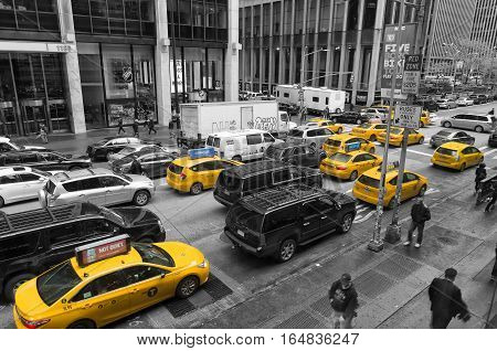NEW YORK - MAY 3 2016: Typically yellow medallion taxicabs in front of the New York Hilton. They are widely recognized icons of the city and come in two varieties: yellow and green.
