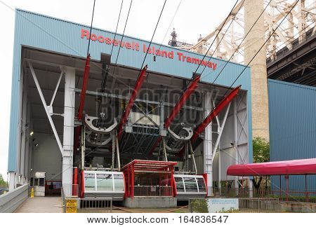 NEW YORK - MAY 3 2016: cable car house of the roosevelt island tramway. Each cabin accommodates a capacity of 125 people makes approximately 115 trips per day and about 100 on weekends.