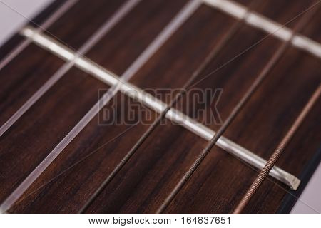 wood guitar strings closeup, stringed musical instrument