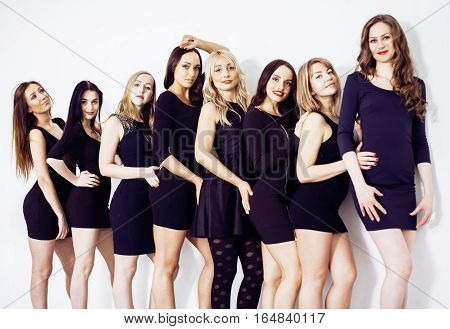 Many diverse women in line, wearing fancy little black dresses, party makeup, vice squad concept close up