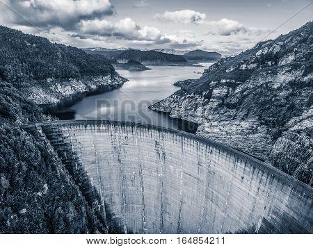 Aerial View Of Gordon Dam And Lake In Black And White. Southwest, Tasmania