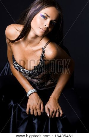 Sexy fashionable woman on black