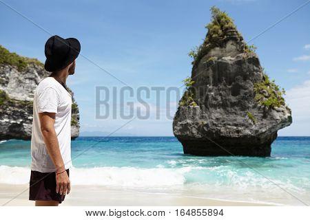Paradise On Earth. Unrecognizable Caucasian Man In Black Headwear Enjoying Ideal Place At Ocean Shor