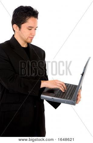 Casual Man Working On A Laptop