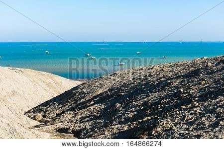 The coastline, azure blue sea and rocks