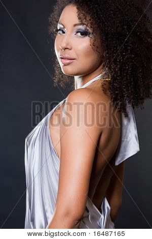 fashionable mulatto woman on black