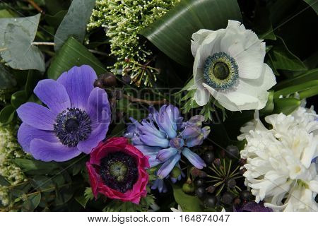 Bridal bouquet: anemones in different shades of pink and purple