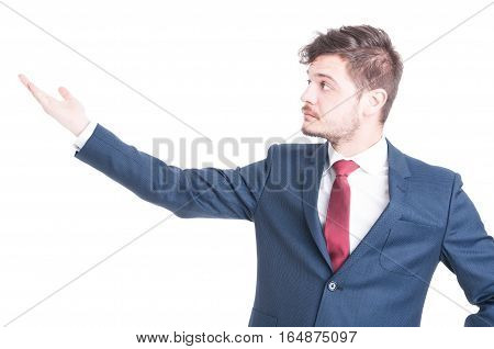 Portrait Of Business Man Showing Something With His Hand