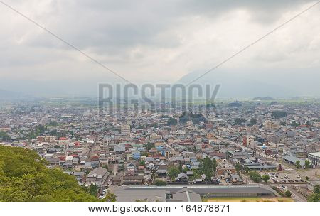 OHNO JAPAN - AUGUST 02 2016: East view of Ohno city from the main keep of Echizen Ohno castle. Ohno city of Fukui Prefecture has 400-years history and was called
