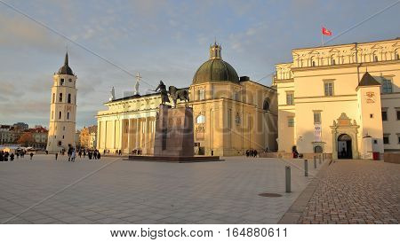 VILNIUS, LITHUANIA - DECEMBER 29, 2016: Cathedral Square with from left to right: The Belfry (Cathedral Clock Tower), the Cathedral and the Palace of the Grand Dukes of Lithuania - Gediminas Monument in the foreground