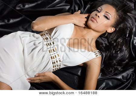 fashionable mulatto woman in white dress