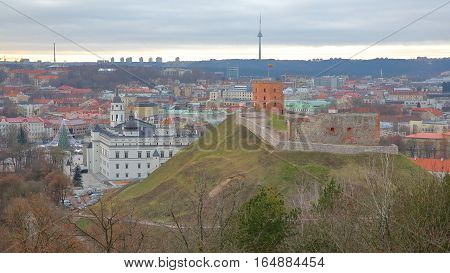 VILNIUS, LITHUANIA: View of Vilnius from the Hill of Three Crosses with the Old Castle on Gediminas Hill in the foreground