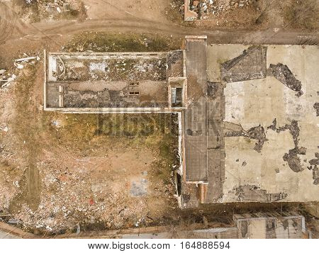 Abandoned industrial building in winter time. Aerial view.