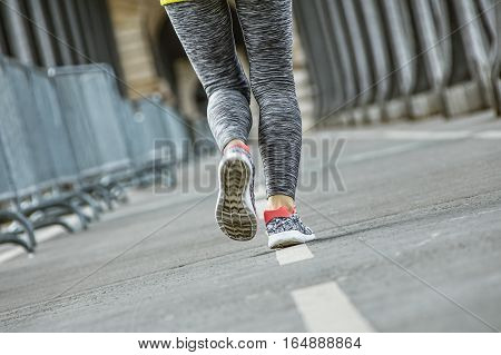 Closeup On Healthy Woman Jogging On Pont De Bir-hakeim Bridge