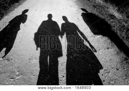Four People Walking Together