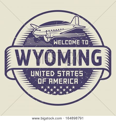 Grunge rubber stamp or tag with airplane and text Welcome to Wyoming United States of America vector illustration