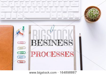 Text Business processes on white paper background / business concept