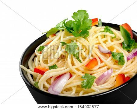 Pasta in a white bowl with tomato sauce and fresh basil set against a white napkin on a white table