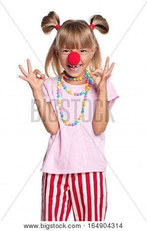 Little girl with clown nose showing ok gesture, isolated on white background