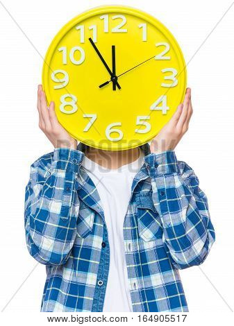 Caucasian teen boy covered his face with clock. Funny teenager showing yellow clock. Child back to school, isolated on white background. Education and time concept or last minute christmas holiday.