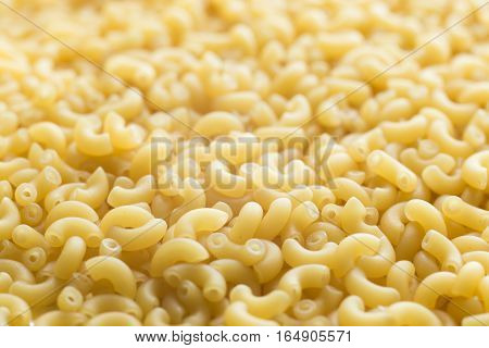 Pasta Raw Closeup Background. Delicious Dry Uncooked Ingredient For Traditional Italian Cuisine Dish
